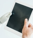 robot and human hand holding blank tablet_sm